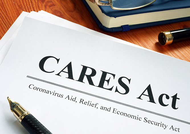 CARES Act cover page on a desk