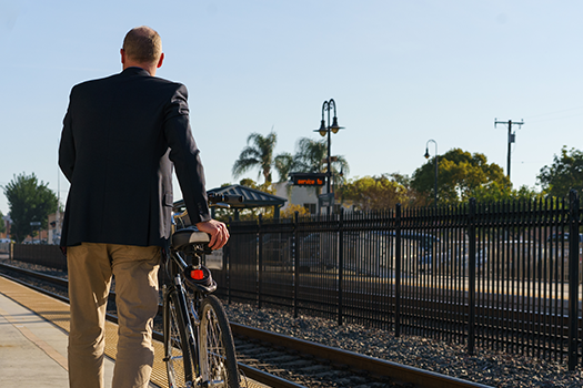 man at the station with a bicycle